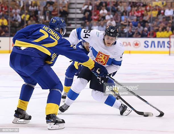 Mikael Granlund of Team Finland stickhandles the puck with pressure from Victor Hedman of Team Sweden during the World Cup of Hockey 2016 at Air...