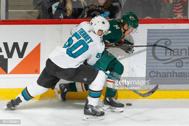 Mikael Granlund of the Minnesota Wild and Chris Tierney of the San Jose Sharks battle for the puck along the boards during the game at the Xcel...