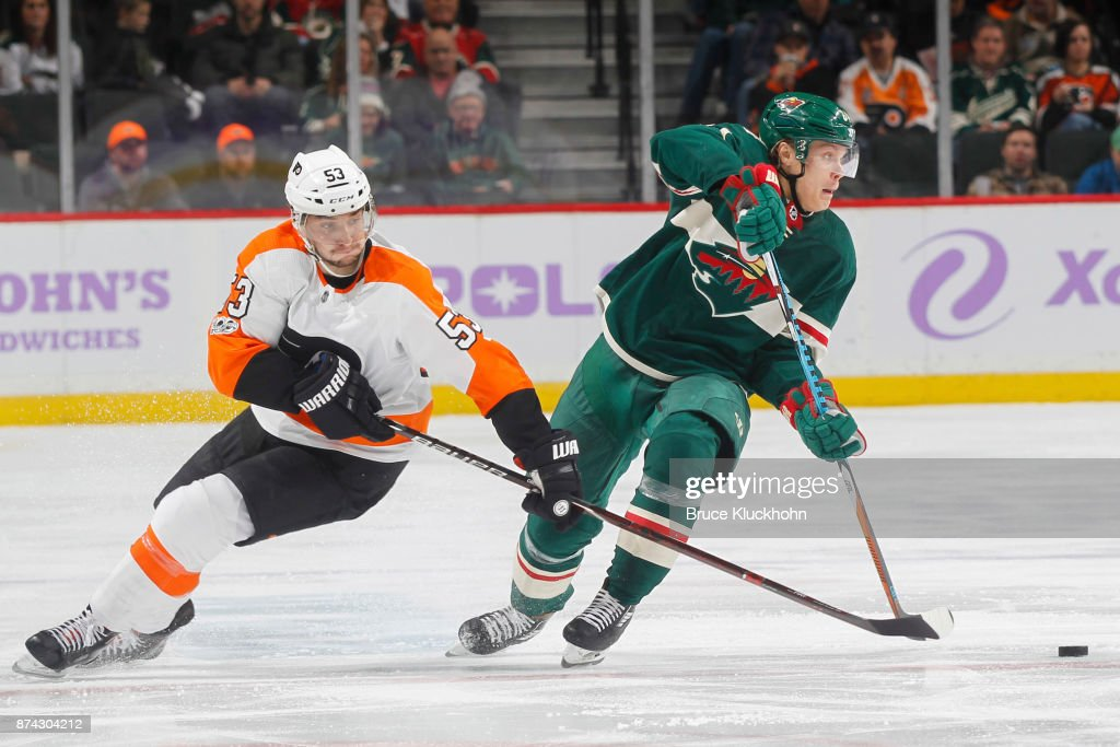 Mikael Granlund #64 of the Minnesota Wild handles the puck with Shayne Gostisbehere #53 of the Philadelphia Flyers defending during the game at the Xcel Energy Center on November 14, 2017 in St. Paul, Minnesota.