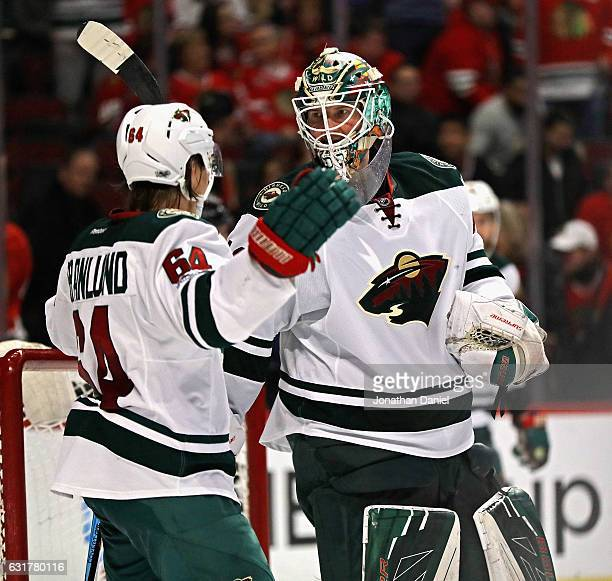 Mikael Granlund of the Minnesota Wild moves to congratulate Devan Dubnyk after a win over the Chicago Blackhawks at the United Center on January 15...