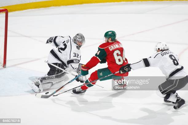 Mikael Granlund of the Minnesota Wild scores the game winning goal in overtime against Drew Doughty and goalie Jonathan Quick of the Los Angeles...