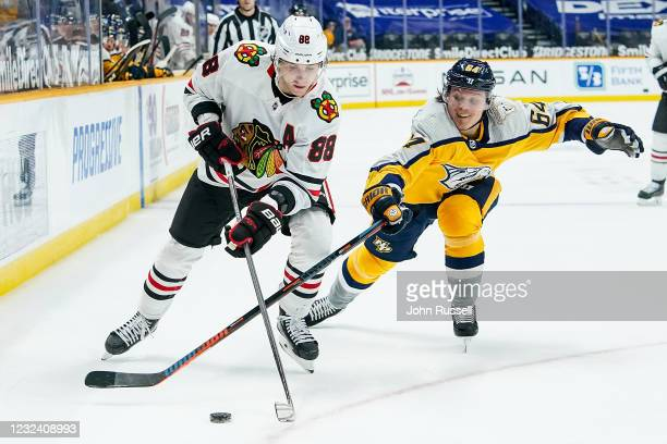 Mikael Granlund of the Nashville Predators battles for the puck against Patrick Kane of the Chicago Blackhawks during the first period at Bridgestone...