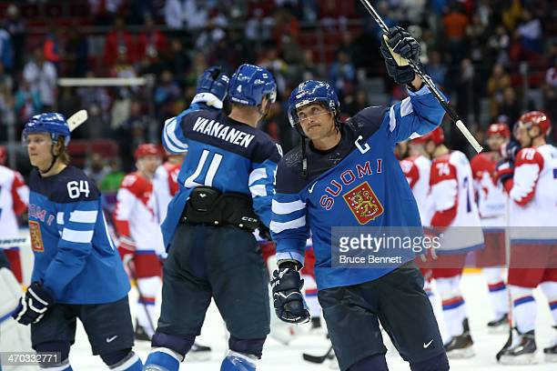 Mikael Granlund Ossi Vaananen and Teemu Selanne of Finland celebrate after defeating Russia 31 during the Men's Ice Hockey Quarterfinal Playoff on...