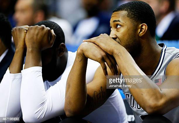Mikael Hopkins of the Georgetown Hoyas and teammates react on the bench in the second half against the Utah Utes during the third round of the 2015...