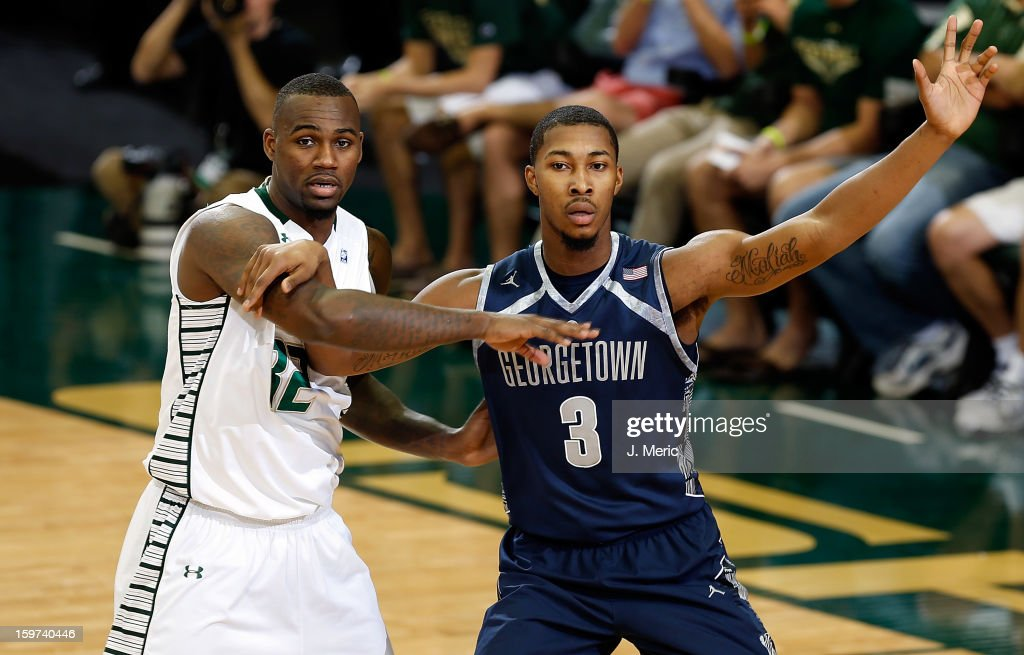 Mikael Hopkins #3 of the Georgetown Hoyas calls for the ball as Toarlyn Fitzpatrick #32 of the South Florida Bulls defends during the game at the Sun Dome on January 19, 2013 in Tampa, Florida.