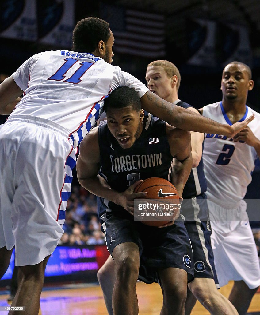 Mikael Hopkins #3 of the Georgetown Hoyas is fouled by Forrest Robinson #11 of the DePaul Blue Demons at the Allstate Arena on February 3, 2014 in Rosemont, Illinois.