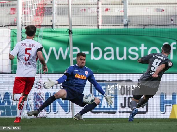 Mikael Ishak of 1. FC Nürnberg scores his team's first goal past Alexander Meyer of SSV Jahn Regensburg during the Second Bundesliga match between...