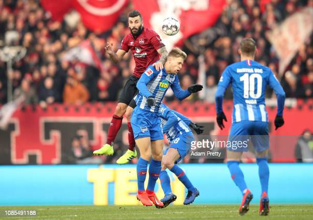 Mikael Ishak of 1 FC Nuernberg competes for a header with Arne Maier of Hertha BSC during the Bundesliga match between 1 FC Nuernberg and Hertha BSC...
