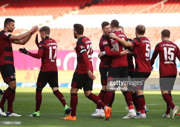 Mikael Ishak of 1. FC Nuernberg is congratulated after scoring a goal during the Second Bundesliga match between 1. FC Nürnberg and SpVgg Greuther...