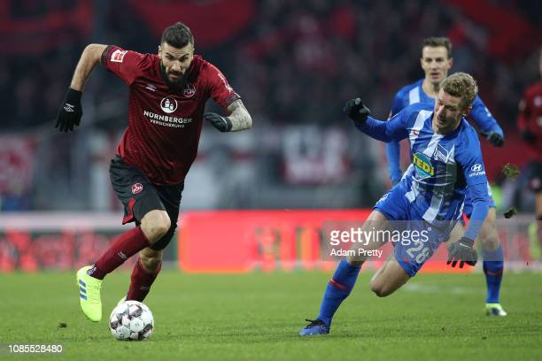 Mikael Ishak of 1 FC Nuernberg runs with the ball away from Fabian Lustenberger of Hertha BSC during the Bundesliga match between 1 FC Nuernberg and...