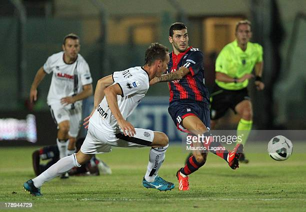 Mikael Ishak of Crotone competes for the ball with Massimo Volta of Cesena during the Serie B match between FC Crotone and AC Cesena at Stadio...