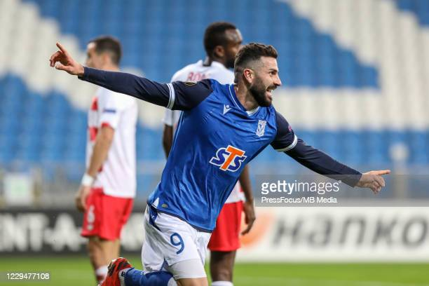 Mikael Ishak of Lech celebrates scoring a goal during the UEFA Europa League Group D stage match between Lech Poznan and Standard Liege at Stadion...