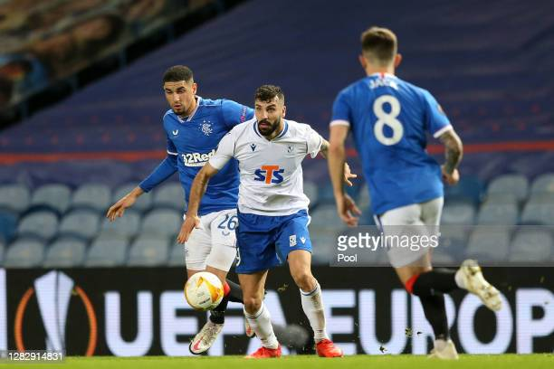 Mikael Ishak of Lech Poznan is challenged by Leon Balogun of Rangers during the UEFA Europa League Group D stage match between Rangers and Lech...