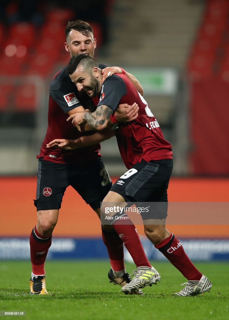 Mikael Ishak of Nuernberg celebrates his team's third goal with team mate Eduard Loewen during the Second Bundesliga match between 1. FC Nuernberg and VfL Bochum 1848 at Max-Morlock-Stadion on September 21, 2017 in Nuremberg, Germany.