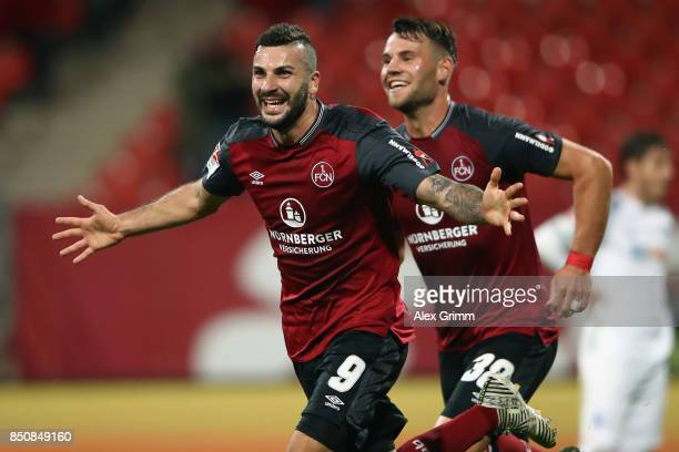 Mikael Ishak of Nuernberg celebrates his team's third goal with team mate Eduard Loewen during the Second Bundesliga match between 1 FC Nuernberg and...