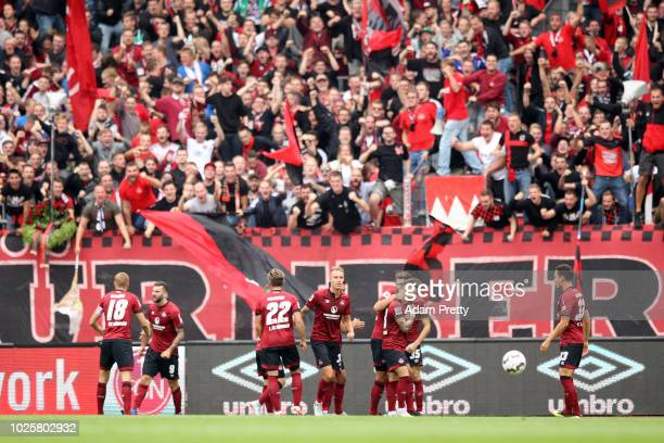 Mikael Ishak of Nuernberg celebrates with teammates after scoring his team's first goal during the Bundesliga match between 1 FC Nuernberg and 1 FSV...