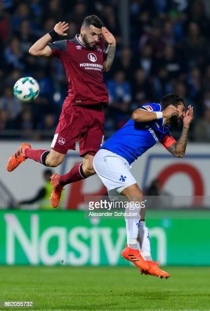 Mikael Ishak of Nuernberg challenges Aytac Sulu of Darmstadt during the Second Bundesliga match between SV Darmstadt 98 and 1 FC Nuernberg at...