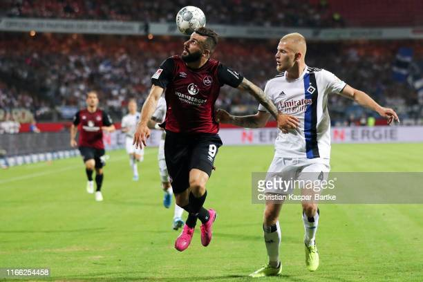 Mikael Ishak of Nuernberg is challenged by Rick van Drongelen of Hamburg during the Second Bundesliga match between 1. FC Nuernberg and Hamburger SV...