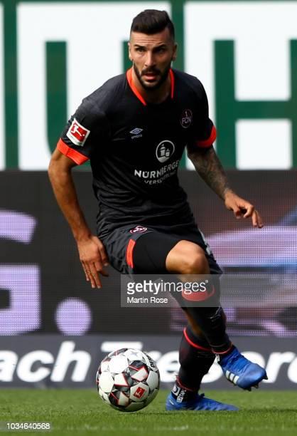 Mikael Ishak of Nuernberg runs with the ball during the Bundesliga match between SV Werder Bremen and 1 FC Nuernberg at Weserstadion on September 16...
