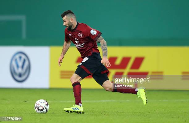 Mikael Ishak of Nuernberg runs with the ball during the DFB Cup match between Hamburger SV and 1. FC Nuernberg at Volksparkstadion on February 05,...