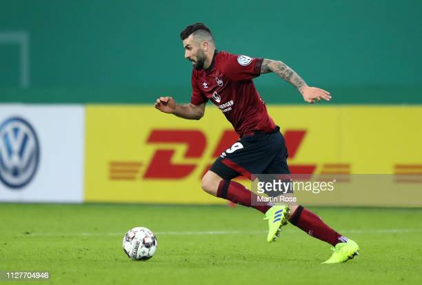 Mikael Ishak of Nuernberg runs with the ball during the DFB Cup match between Hamburger SV and 1 FC Nuernberg at Volksparkstadion on February 05 2019...