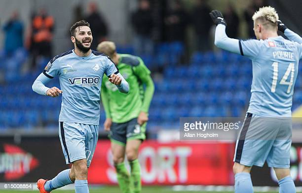 Mikael Ishak of Randers FC and Marvin Pourie of Randers FC celebrates after scoring their third goal during the Danish Alka Superliga match between...