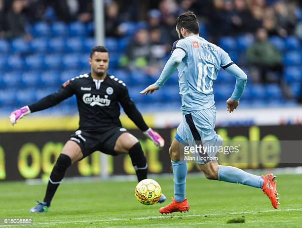 Mikael Ishak of Randers FC and Sten Michael Grytebust of OB compete for the ball during the Danish Alka Superliga match between Randers FC and OB...