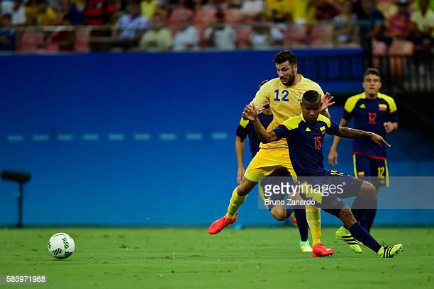 Mikael Ishak player of Sweden battles for the ball with Wilmar Barrios player of Colombia during 2016 Summer Olympics match between Colombia and...