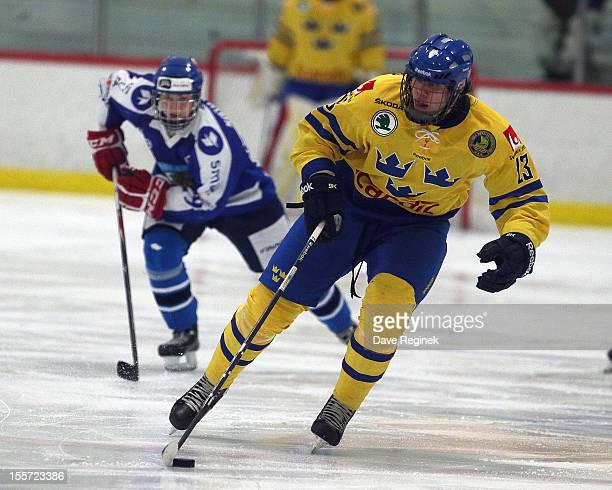 Mikael Johansson of team Sweden skates up ice with the puck during the U-18 Four Nations Cup game against team Finland late on November 7, 2012 at...