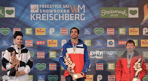 Mikael Kingsbury Anthony Benna and Alexandr Smyshlyaev receive their medals in Men's Moguls final at the FIS Freestyle World Ski Championship in...