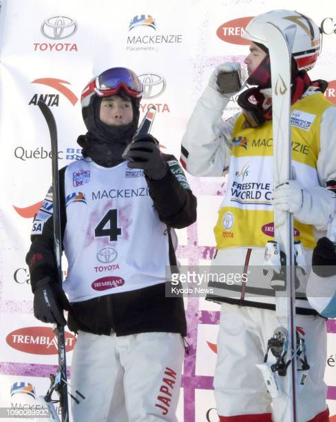Mikael Kingsbury of Canada and Ikuma Horishima of Japan are pictured after finishing first and second respectively in a men's moguls World Cup event...