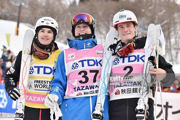 Mikael Kingsbury of Canada Bradley Wilson of the USA and Matt Graham of Australia pose after the Men's Mogul during the FIS Freestyle Ski World Cup...
