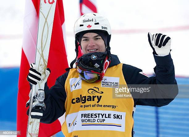 Mikael Kingsbury of Canada celebrates his first place finish during the men's moguls finals at the FIS Freestyle Ski World Cup January 4 2014 in...