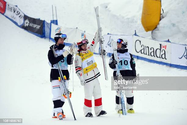 Mikael Kingsbury of Canada celebrates his first place finish with second place Walter Wallberg of Sweden and third place Daichi Hara of Japan after...