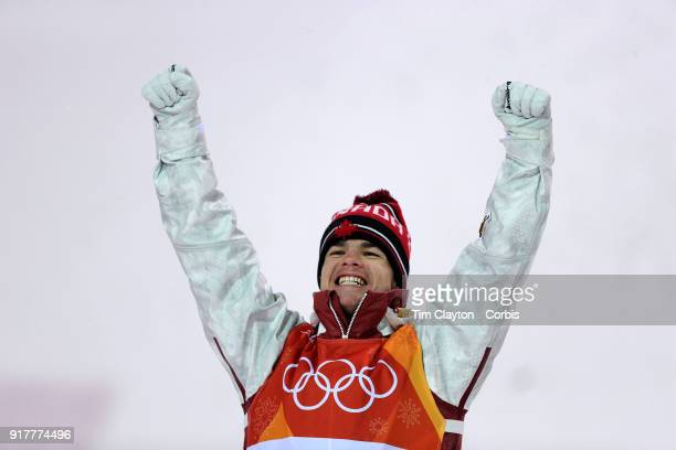 Mikael Kingsbury of Canada celebrates his gold medal win in the Freestyle Skiing Men's Moguls competition at Phoenix Snow Park on February 12 2018 in...