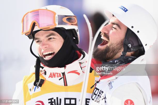 Mikael Kingsbury of Canada celebrates with Philippe Marquis of Canada during day one of the Men's FIS Freestyle Skiing World Cup Tazawako on February...