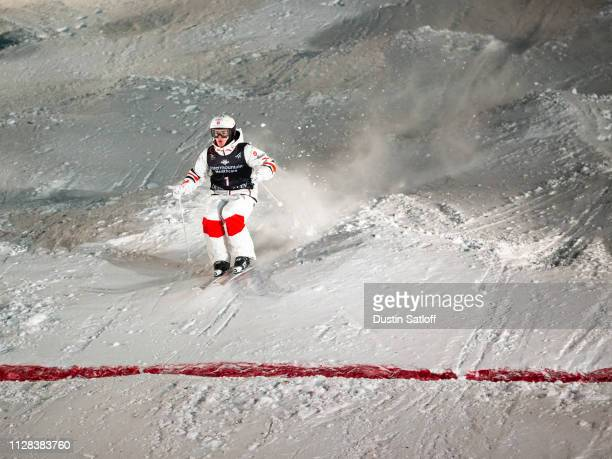 Mikael Kingsbury of Canada crosses the finish line on his way to winning the Men's Moguls Final of the FIS Freestyle Ski World Championships on...