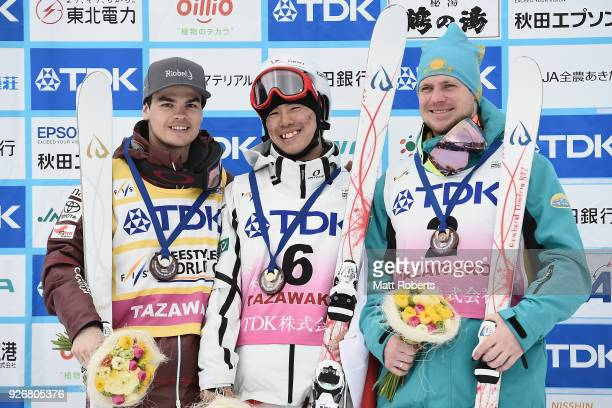 Mikael Kingsbury of Canada Ikuma Hiroshima of Japan and Dmitriy of Kazakhstan celebrate during day one of the FIS Freestyle Skiing World Cup Tazawako...
