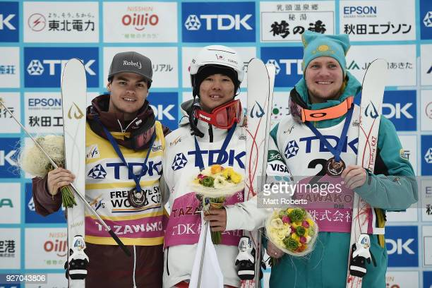 Mikael Kingsbury of Canada Ikuma Hiroshima of Japan and Dmitriy Reikherd of Kazakhstan pose with their medals after the Men's Dual Moguls during day...