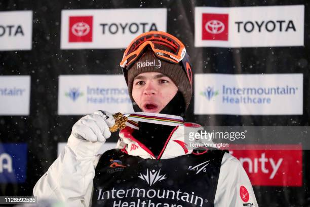 Mikael Kingsbury of Canada in first place celebrates on the podium in the Men's Dual Moguls Final of the FIS Freestyle Ski World Championships on...