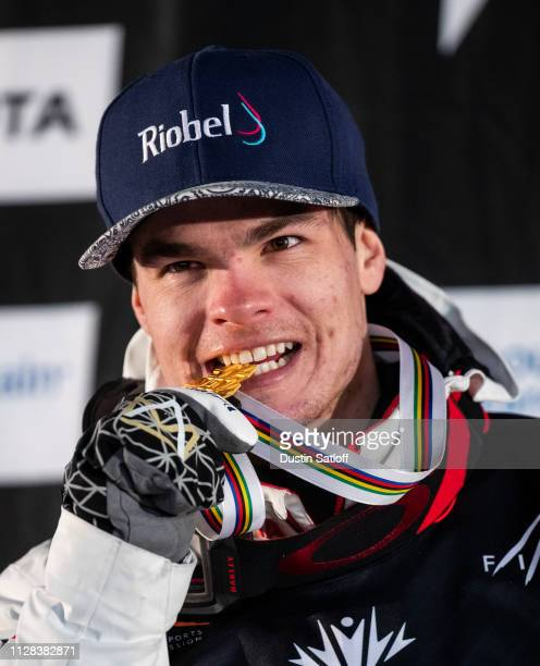 Mikael Kingsbury of Canada poses with a gold medal on the podium after finishing first place in the Men's Moguls Final of the FIS Freestyle Ski World...