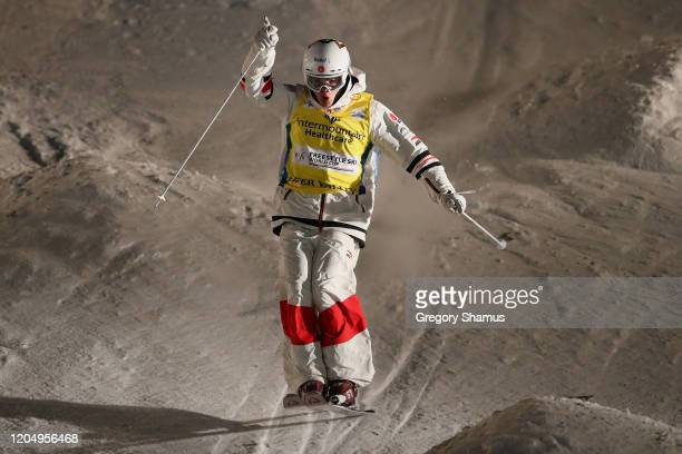Mikael Kingsbury of Canada reacts as he approaches the finish line to win the Men's Dual Moguls at the FIS Freestyle Ski World Cup at Deer Valley on...