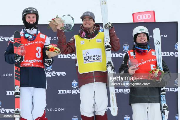 Mikael Kingsbury of Canada takes 1st place Benjamin Cavet of France takes 2nd place Bradley Wilson of USA takes 3rd place during the FIS Freestyle...