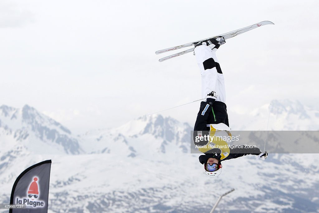 Mikael Kingsbury of Canada takes first place and wins the Overall Freestyle World Cup globe during the FIS Freestyle Ski World Cup Men's and Women's Dual Moguls on March 21, 2014 in La Plagne, France.