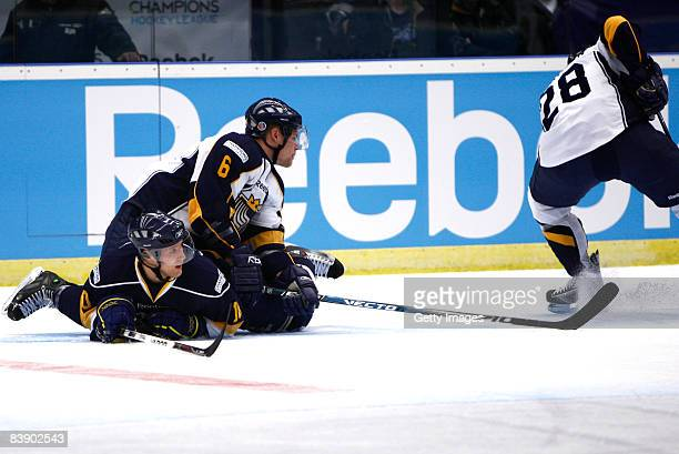 Mikael Kurki and Andreas Falk fights for the puck during the IIHF Champions Hockey League match between HV 71 Joenkoeping and Espoo Blues on December...