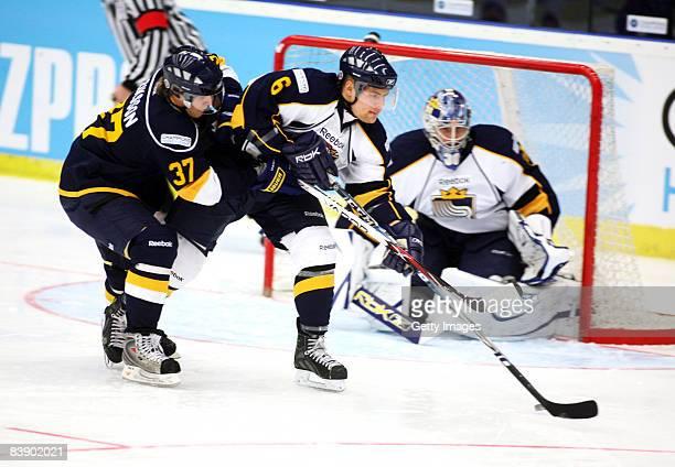 Mikael Kurki and Heeeeenrik Eriksson of Espoo in action during the IIHF Champions Hockey League match between HV 71 Joenkoeping and Espoo Blues on...