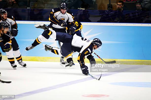 Mikael Kurki flies and gets hurt during the IIHF Champions Hockey League match between HV 71 Joenkoeping and Espoo Blues on December 3, 2008 in...