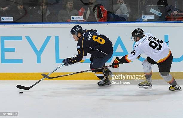 Mikael Kurki of Espoo Blues and Christian Dube of Bern fight for the puck during the IIHF Champions Hockey League match between Espoo Blues and SC...