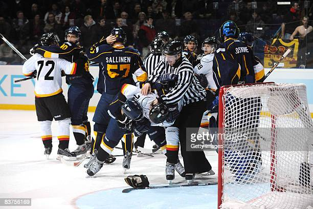 Mikael Kurki of Espoo Blues fights for the puck during the IIHF Champions Hockey League match between Espoo Blues and SC Bern on November 19, 2008 in...