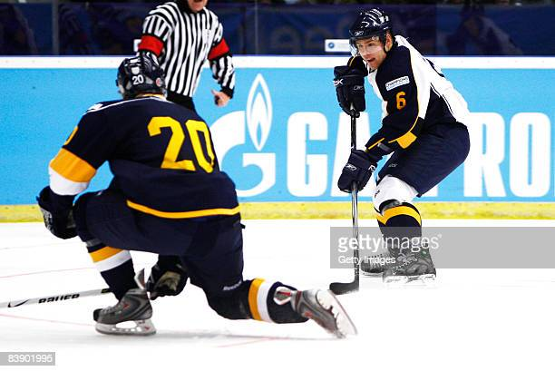Mikael Kurki of Espoo Blues fights for the puck during the IIHF Champions Hockey League match between HV 71 Joenkoeping and Espoo Blues on December...